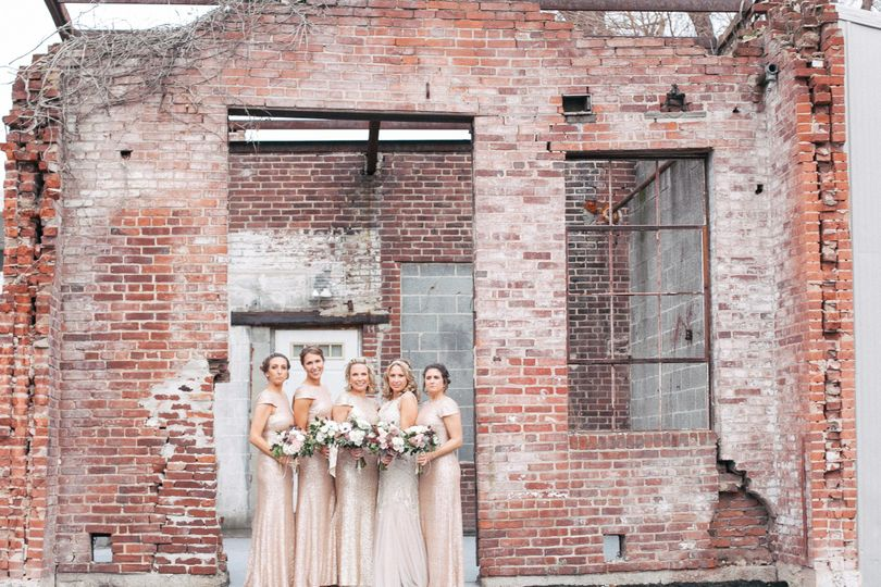 Glam-chic bridal party at The Bond in York PA. Flowers by Foster's and beauty squad represented by...