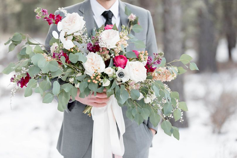 Bridal bouquet held by the gro