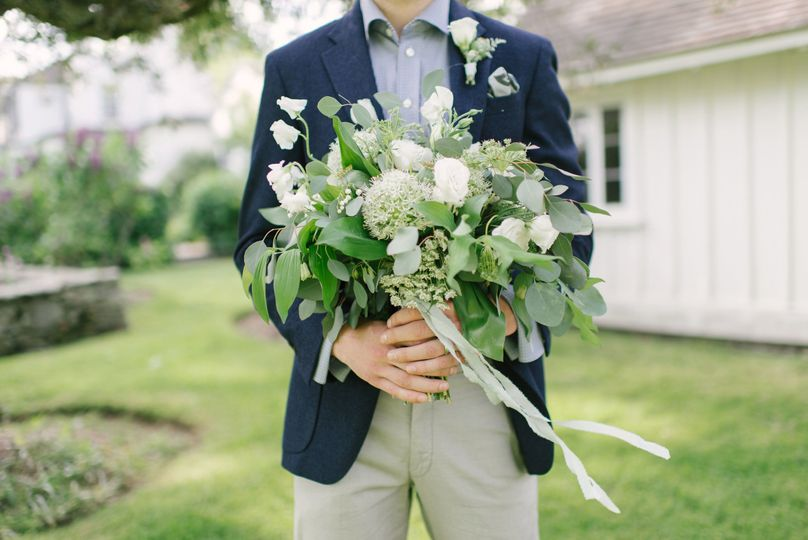 Groom holding a bouquet