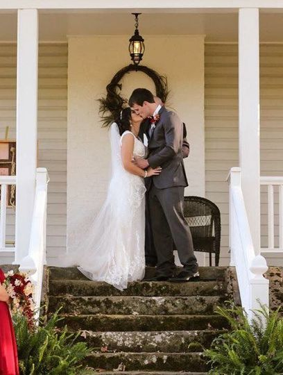 Couple kiss at the porch