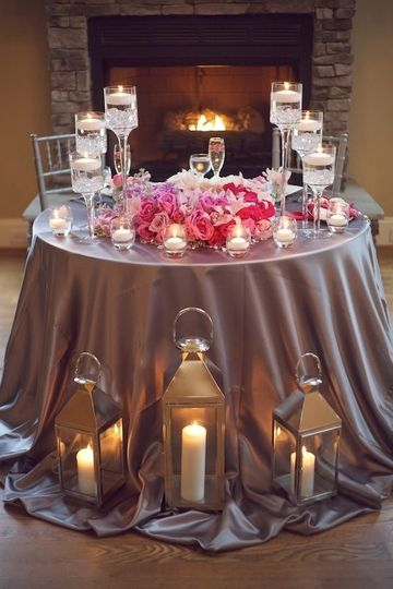 Table setup with candle and floral centerpiece
