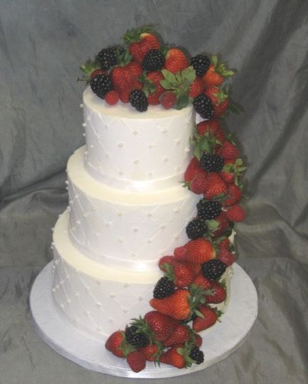 Three tier cake with fruits