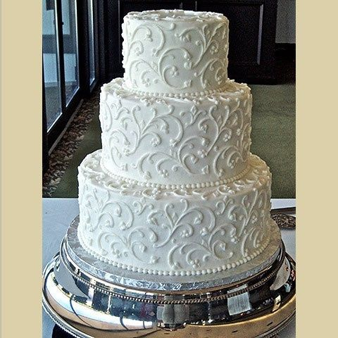 Three tier cake with embellishments