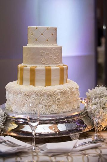 Four tier gold and white cake