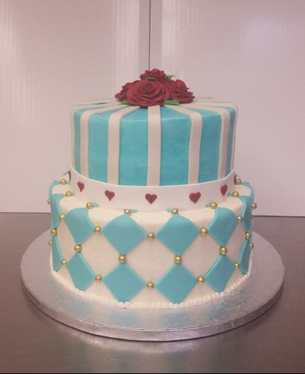 800x800 1462999703191 alice in wonderland stack cake