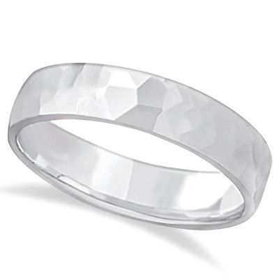 Hammered Finished Carved Wedding Band	  A rough exterior hides a rounded comfort-fit interior for...