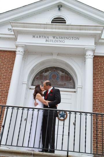 Couple kissing on the balcony