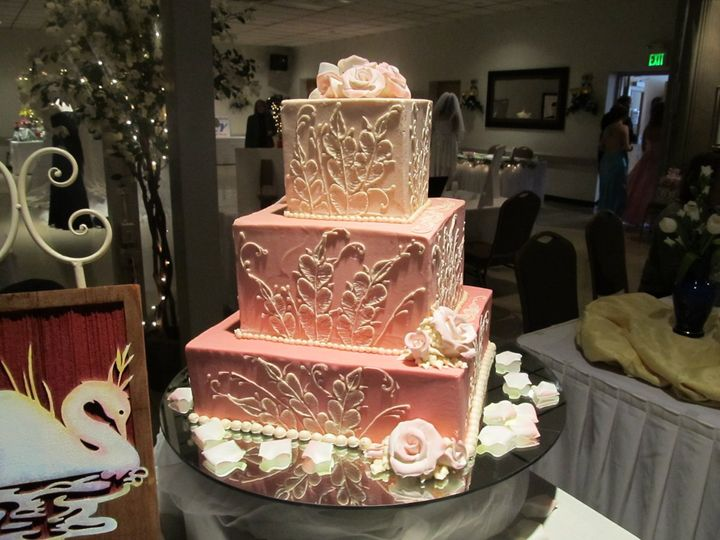 Stunning pink shaded cake with a hand-painted design