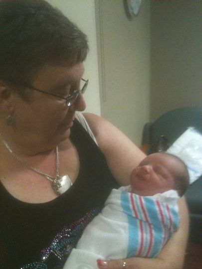 Holding my newest grandson for the first time