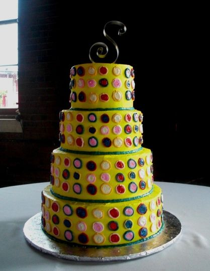 Buttercream covered caked decorated to look like Polka Dot Chuck Taylor Converse shoes the bride...
