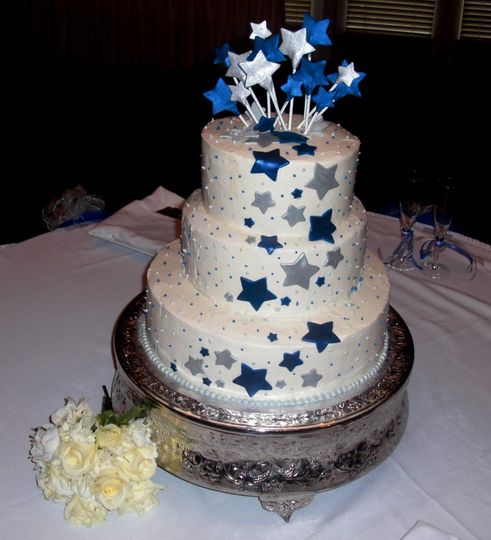 Starry Love.  Buttercream covered cake with fondant silver and blue stars.