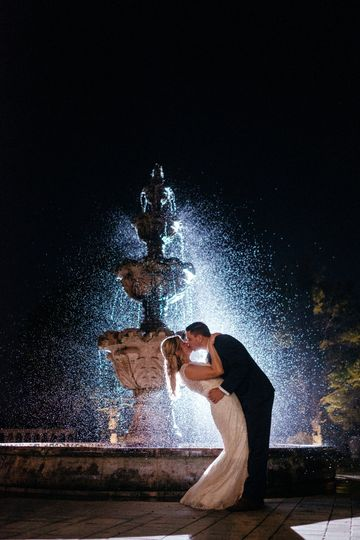 Dip and kiss by the fountain