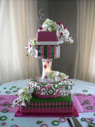 Multi tiered, multi shapes with pedestal (riser) vase filled with orchids and lights.  Watermelon...