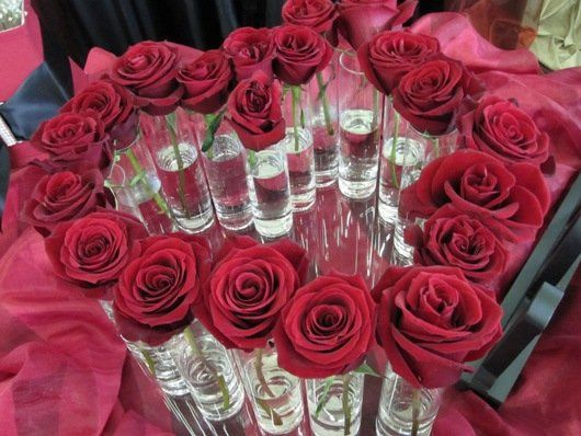 roses in bud vases shaped like a heart