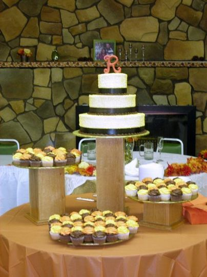 Wedding Cake plus cupcakes on oak stands
