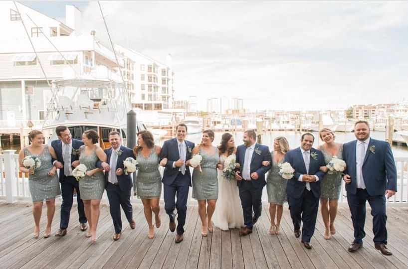 Newlyweds, bridesmaids, and groomsmen on the dock
