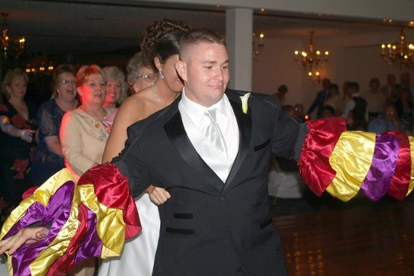 The groom leads them into the night with fun and laughter.