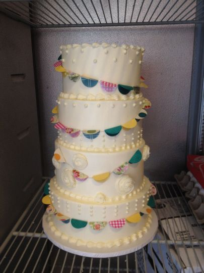 4-tier wedding cake with colorful banners