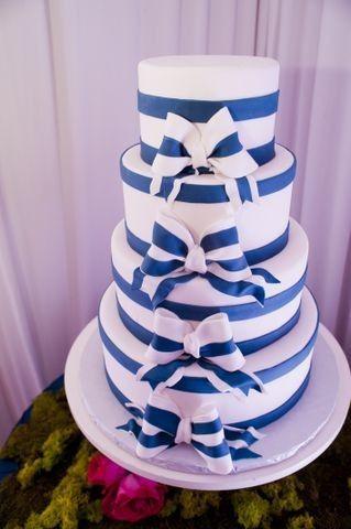 White and blue ribbon wedding cake