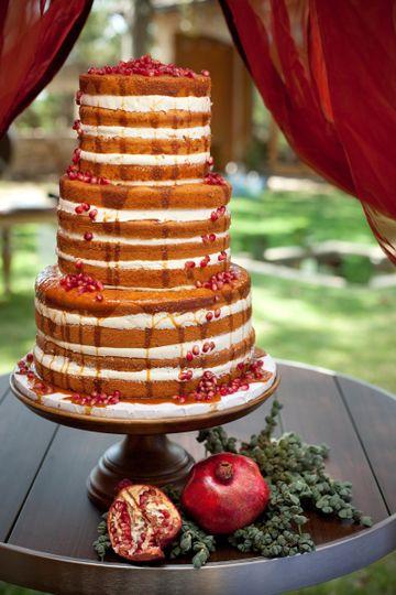 naked cake with pomegranites