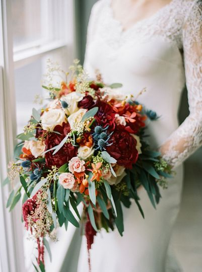 Sleeved bridal dress and wedding bouquet