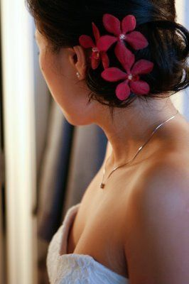 Low bun with pink flowers