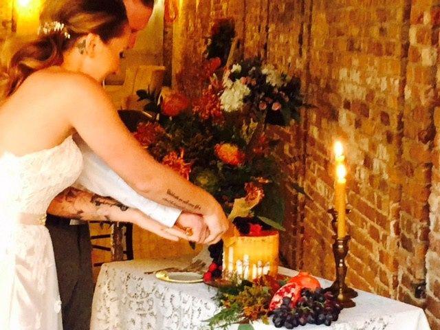 Couple slicing their wedding cake
