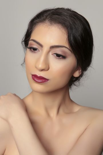 Red lip and subtle eyeshadow work