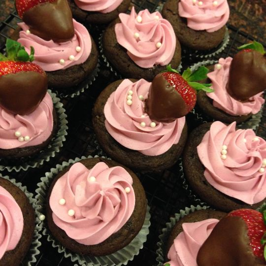A Valentine's favorite - an espresso chocolate cake topped with strawberry buttercream, garnished...