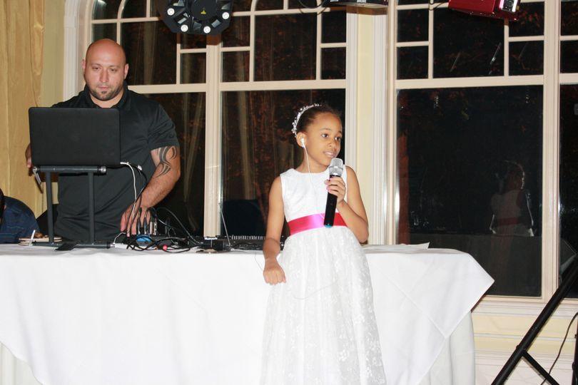 Junior bridesmaid with the DJ