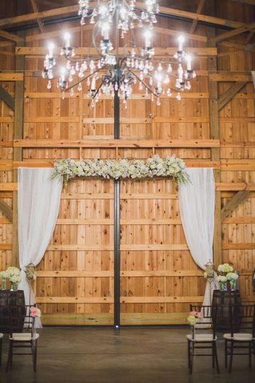 Floral arch decor and chandelier