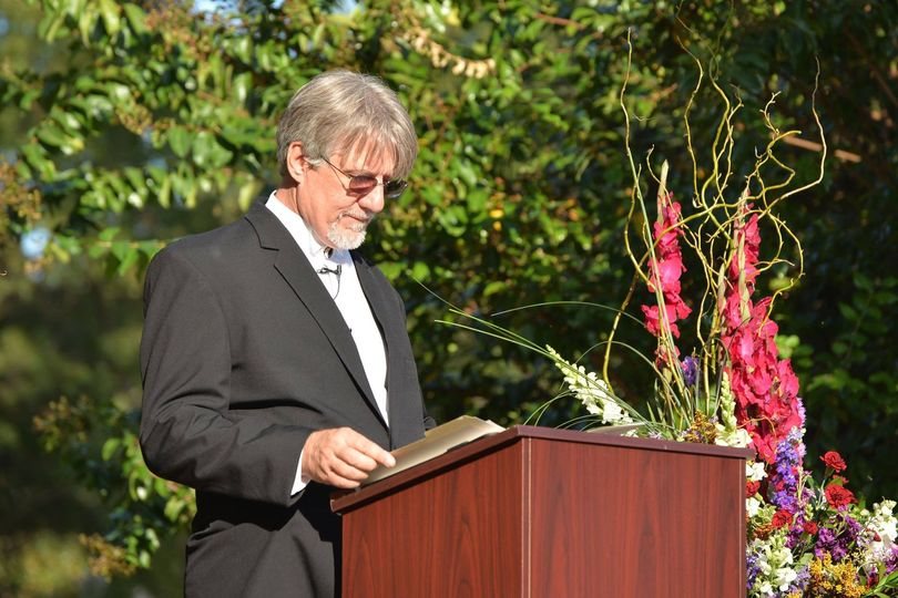 Officiant at the podium | Photos by Anthony Corbin