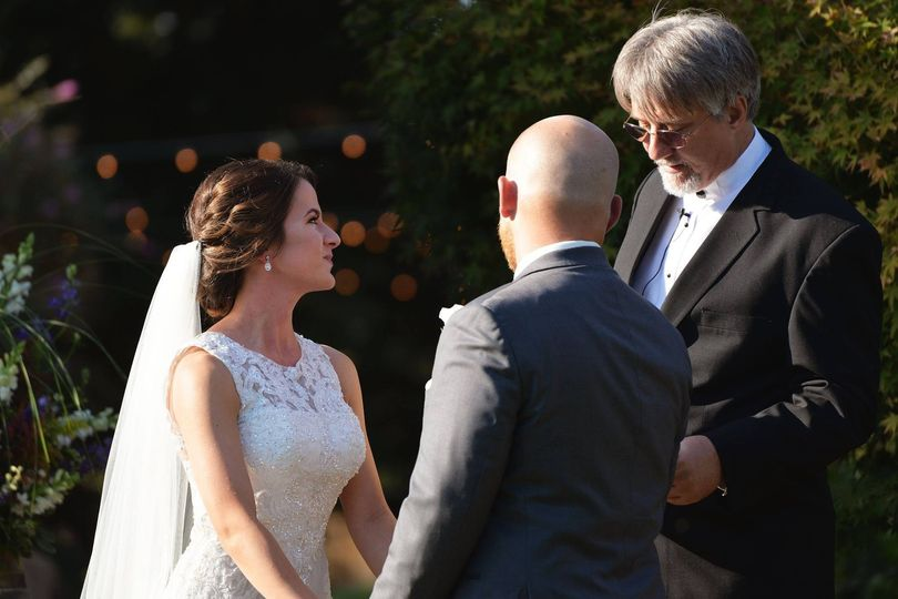 Couple looking at the officiant | Photos by Anthony Corbin