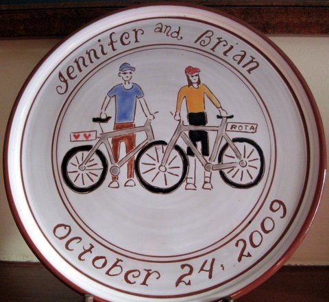 Clay plate with drawing of couple with their favorite outdoor sport.