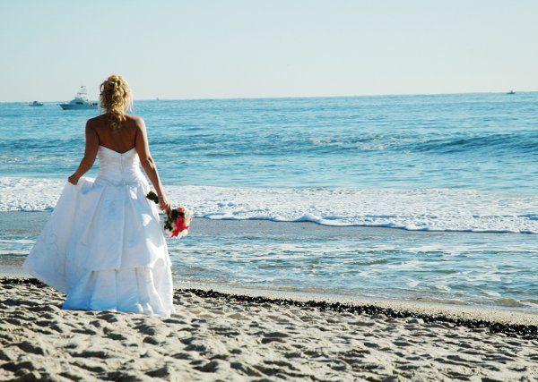 Bride walking on the beach