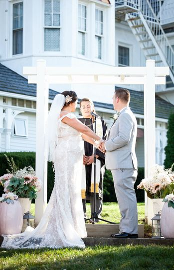 Emily officiating a Wedding