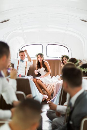 Newlyweds and their guests in the bus