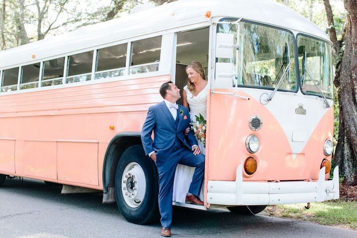 Newlyweds stepping out of the Vintage VW Bus