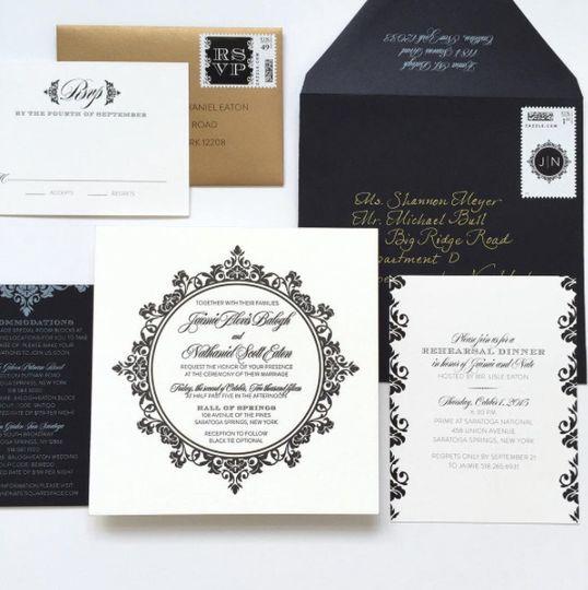 Ornate black and gold wedding invitation