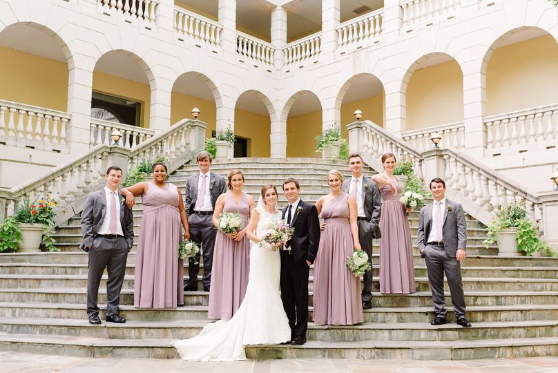 Newlyweds and their guests on the stairs