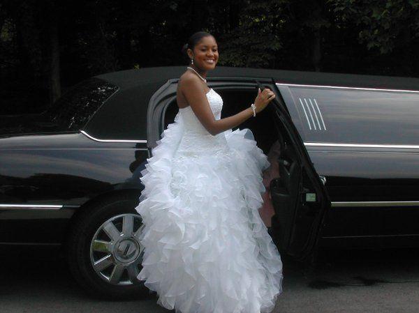 Bride and the classic black limousine