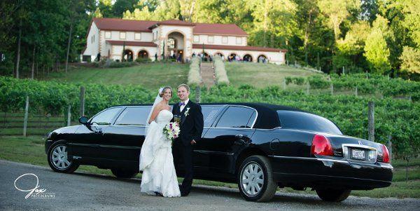 Newlyweds outside the limo