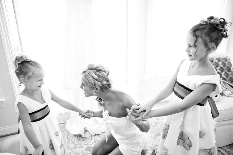 Bride chatting with the flower girls