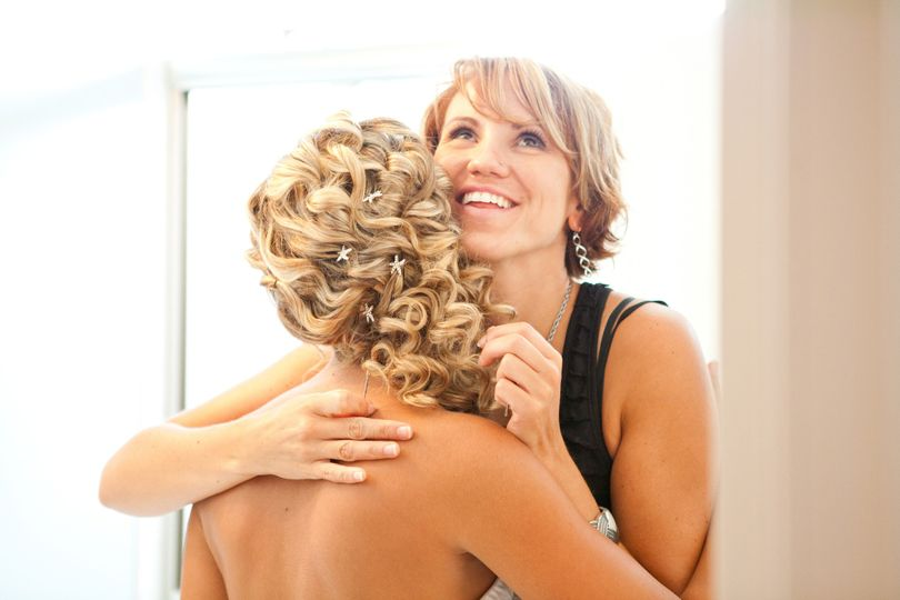 Bride hugging her friend