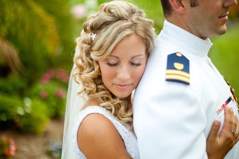 Bride back hugs  her groom