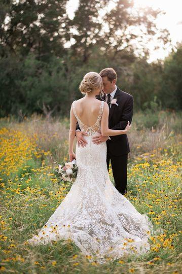 Bride and Groom in wildflowers