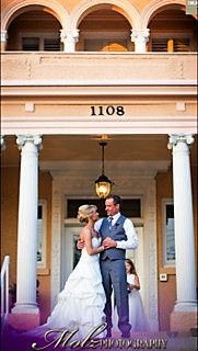 Newlyweds in front of venue facade
