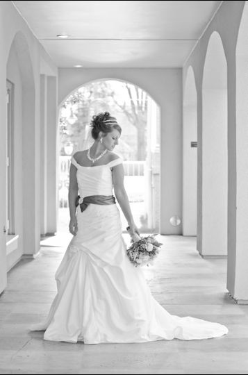 Bride posing by the hall