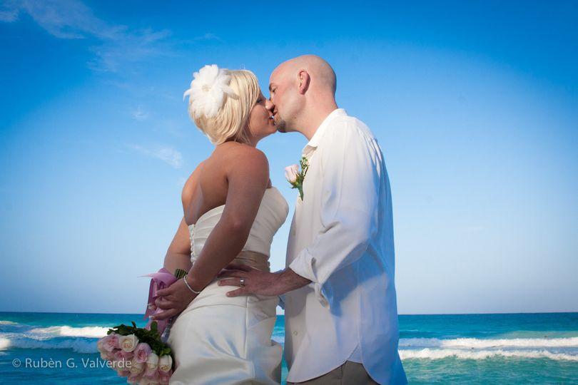 Wedding kiss at the beach