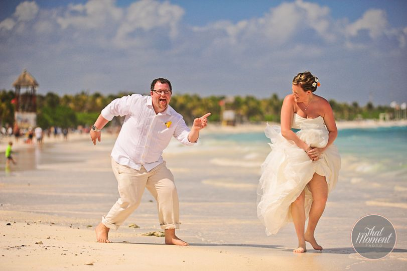 Newlyweds dancing at the beach